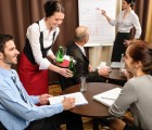 3087590-waitress-serving-business-people-conference-room